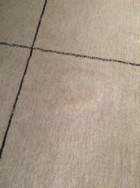 Vetvlek uit tapijt verwijderen